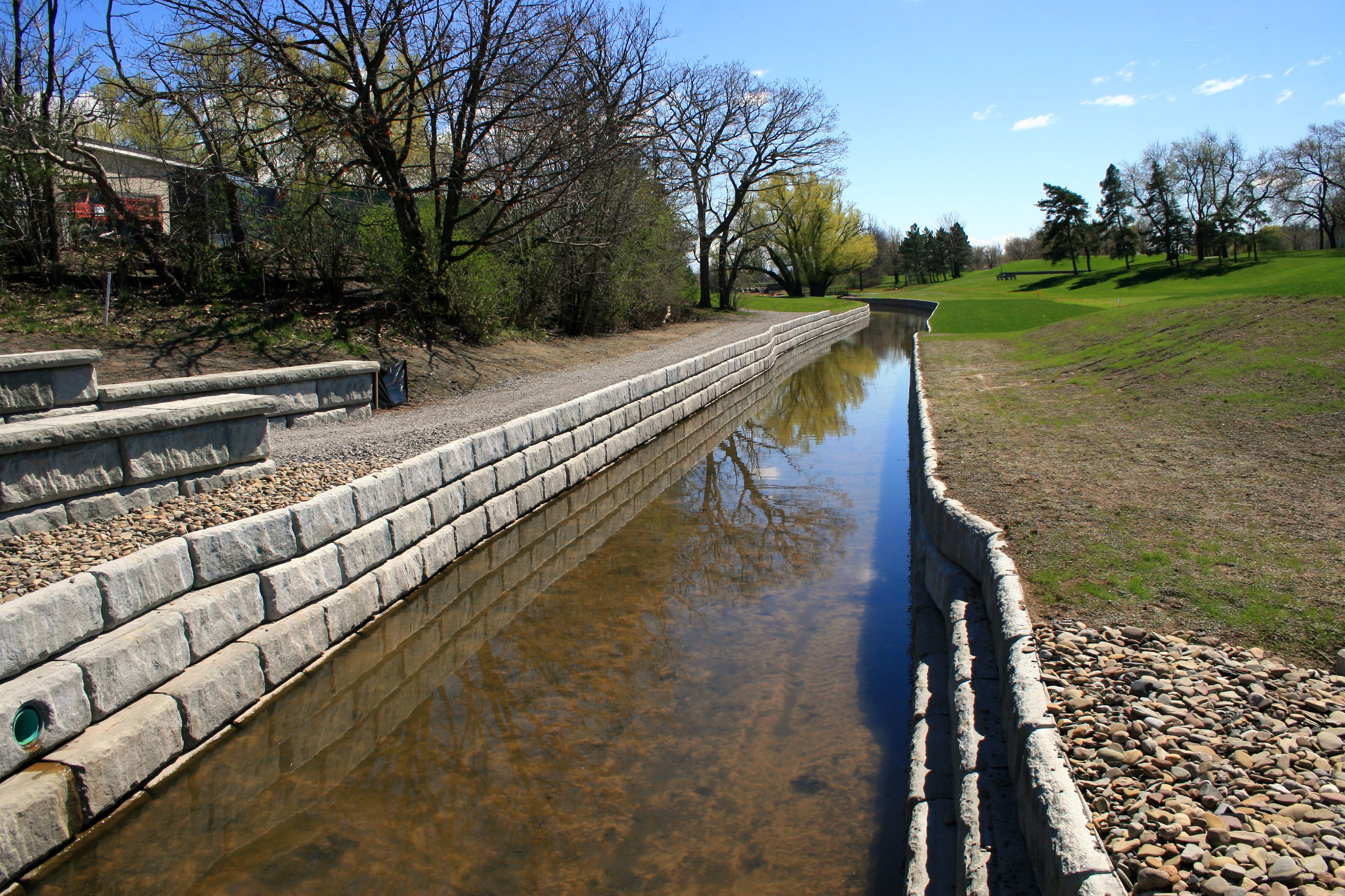 Renovated golf course storm channel supported by Limestone retaining walls