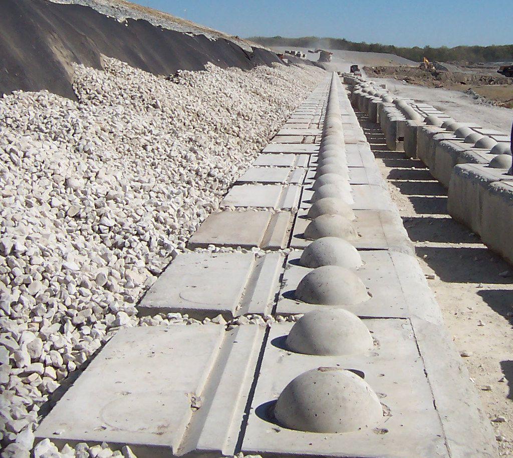 Base course of Redi-Rock retaining wall blocks