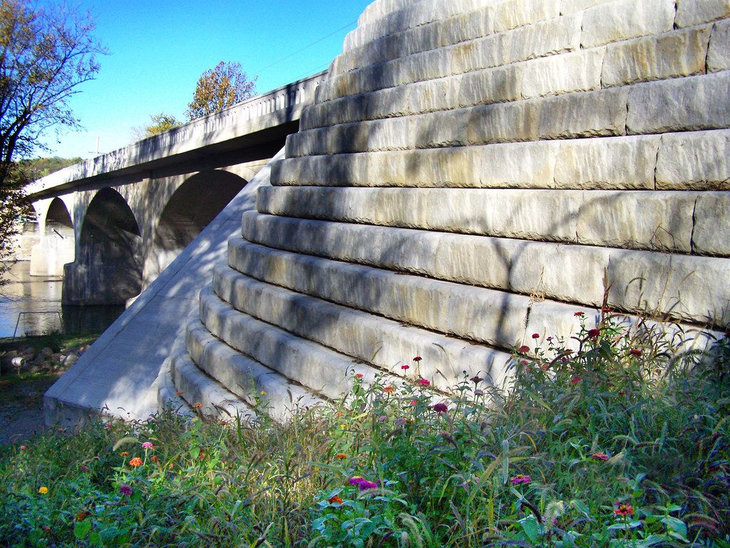 Bridge accented by Limestone setback walls