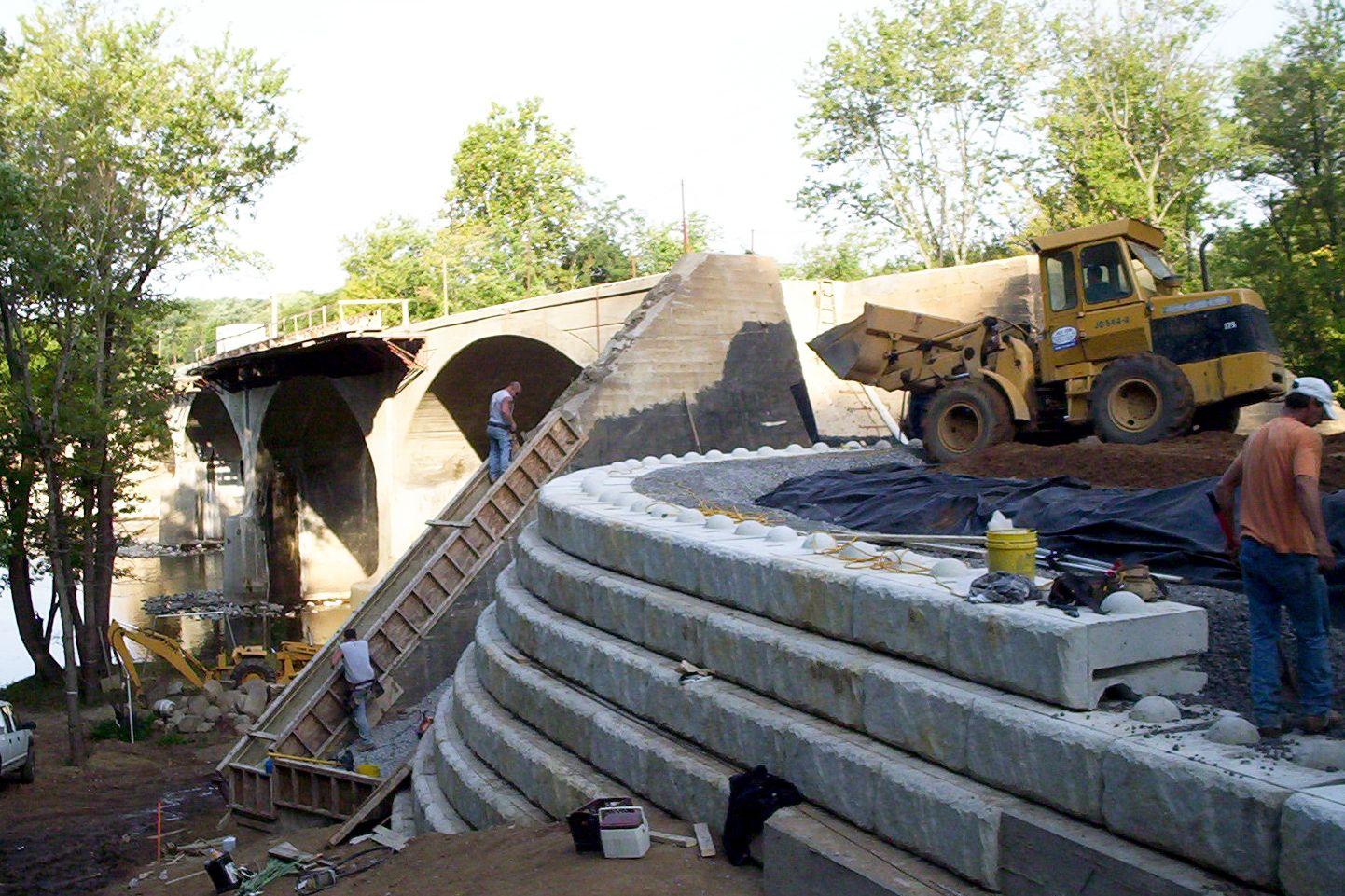 Bridge retaining wall installation