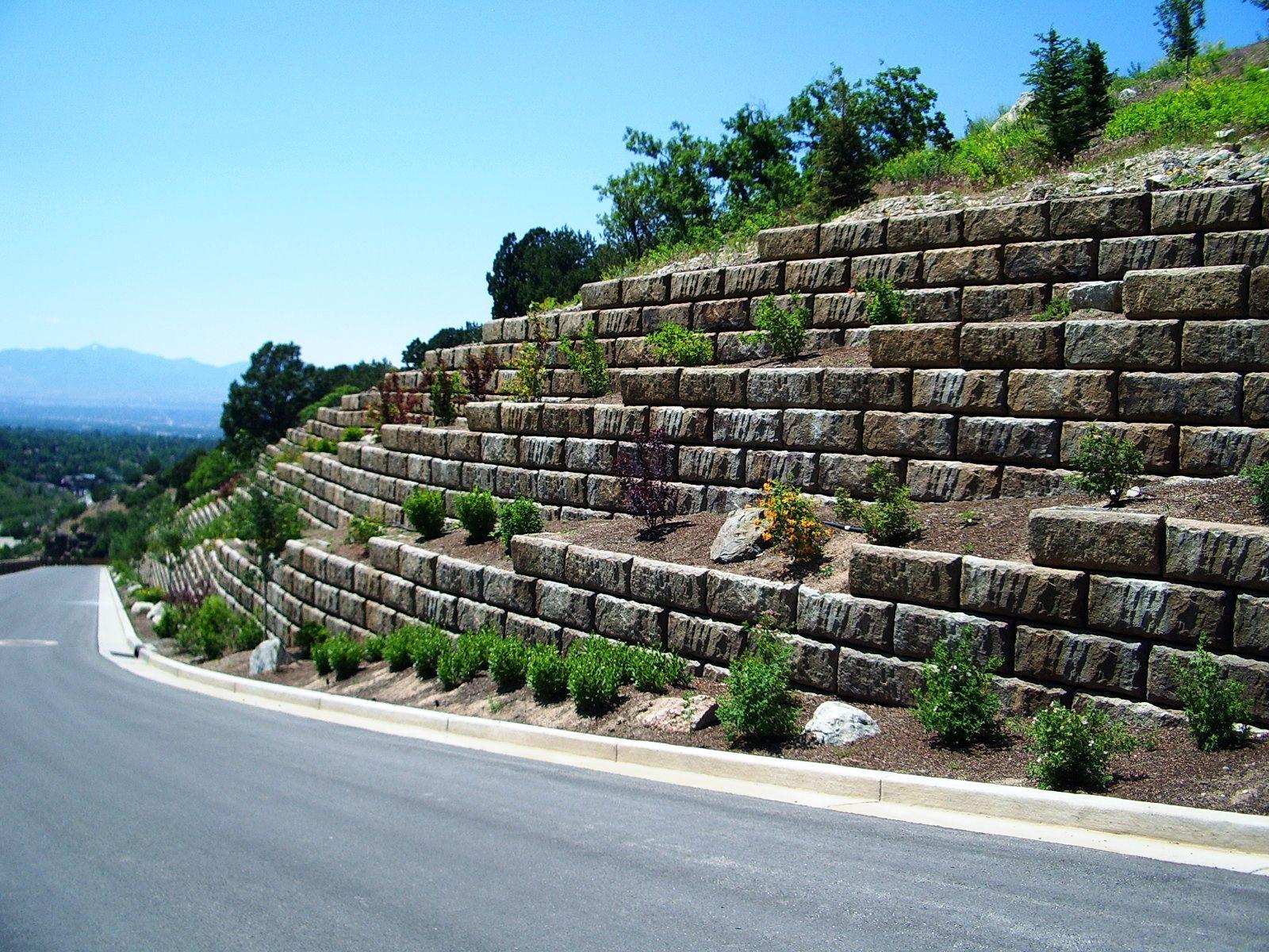 Development entrance featuring tiered Limestone walls