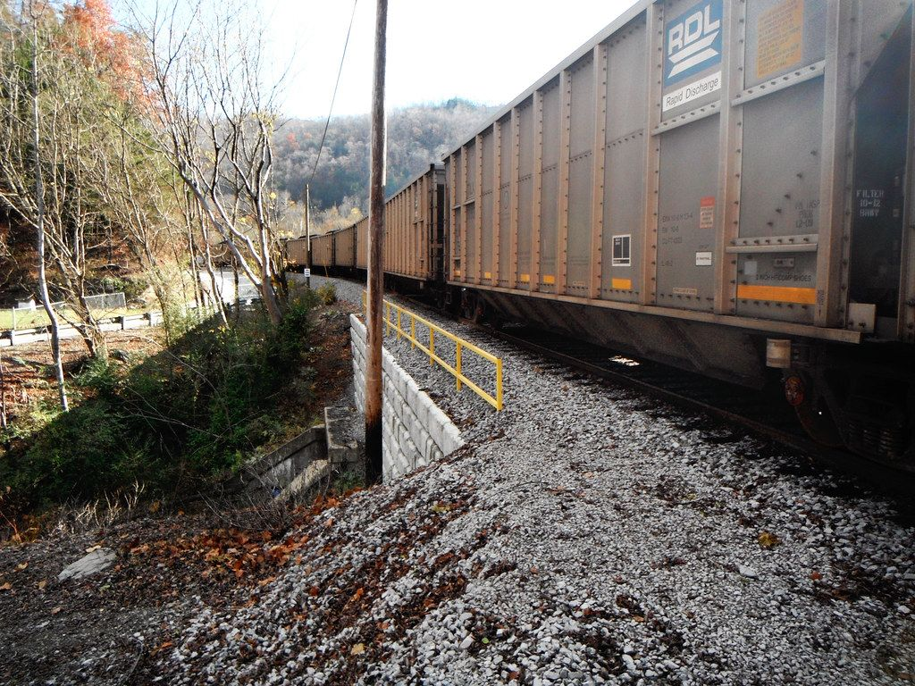 Train passing over culvert supported by Redi-Rock retaining wall blocks
