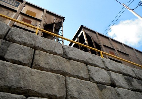 Rail yard using a limestone texture Redi-Rock retaining wall