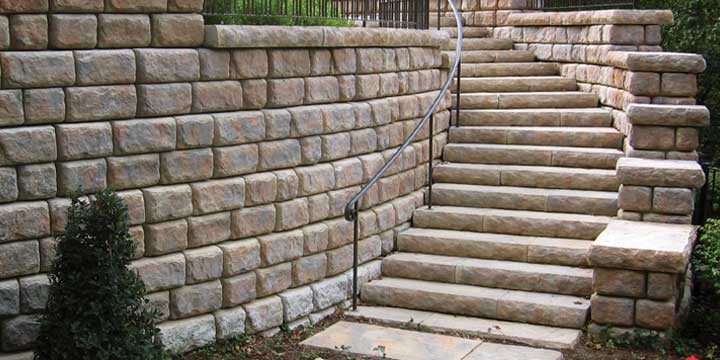 Cobblestone wall with Redi-Rock steps