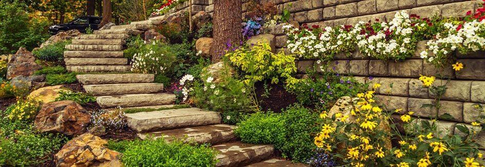 Redi-Rock steps wind down a hillside garden