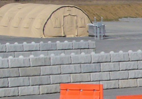 Freestanding limestone walls in front of military barracks