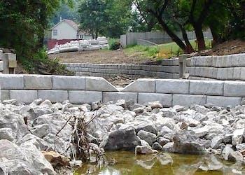 Channel Walls Slow Water to Protect Neighborhood